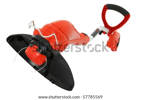 New clean weed trimmer over white background. - stock photo