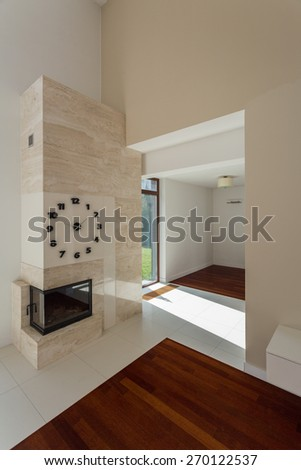 New clock above white marble fireplace in lounge - stock photo