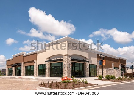 New Commercial, Retail and Office building Space available for sale or lease in mixed use Storefront and office building with awning - stock photo