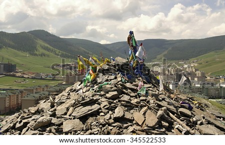 New construction of buildings and Holly hill in the capital city Ulaanbaatar,Mongolia - stock photo