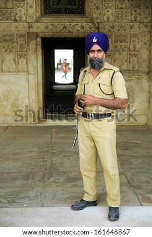 NEW DELHI, INDIA - APRIL, 2013: Indian sikh security at red fort - stock photo
