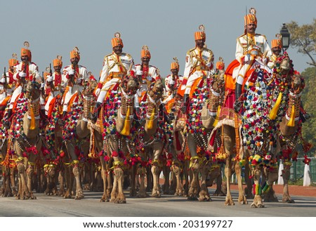 NEW DELHI, INDIA - JANUARY 23, 2008: Soldiers of the Indian Border Security Force riding their camels down the Raj Path in preparation for the annual Republic Day Parade - stock photo