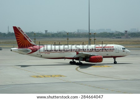 NEW DELHI, INDIA - MAY 24, 2015: Air India Airbus A320 on the tarmac at Indira Gandhi International Airport. Air India is the flag carrier airline of India. - stock photo