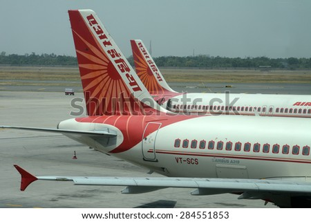 NEW DELHI, INDIA - MAY 24, 2015: Tail sections of Air India Airbus A320 on the tarmac at Indira Gandhi International Airport. Air India is the flag carrier airline of India. - stock photo