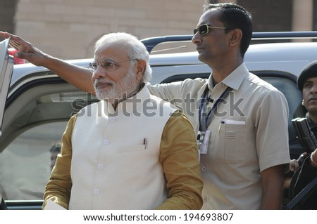 NEW DELHI-MAY 20:  Prime Minister Narendra Modi  being guarded towards press conference at Rashtrapati Bhavanon May 20, 2014 in New Delhi , India.  - stock photo