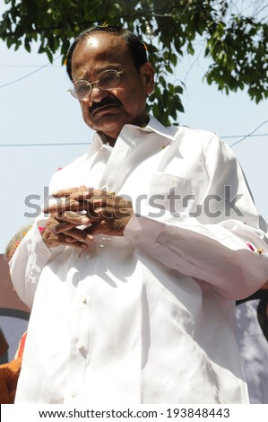 NEW DELHI-MAY 16:  Venkaiah Naidu -Former BJP party president standing on the podium  after BJP won the historic  Indian National election on May 16, 2014 in New Delhi , India.  - stock photo
