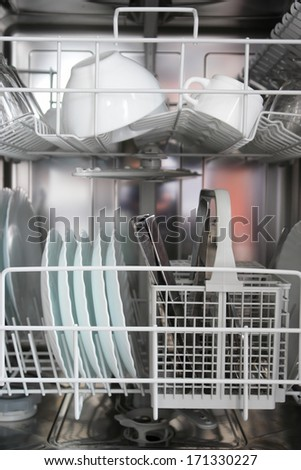 new dishwasher in a kitchen.... - stock photo