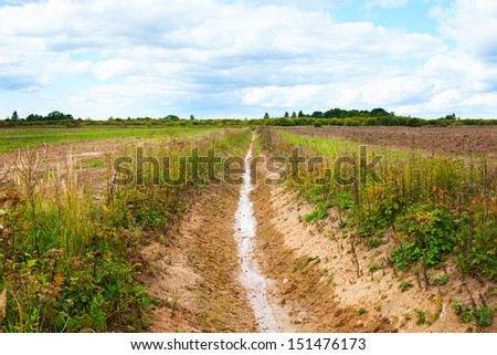 New ditch in new field. - stock photo