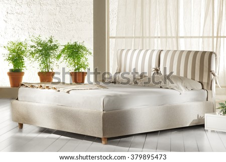NEW ELEGANT COLLECTION . MINIMAL BED DESIGNS IN WHITE AND NATURAL COLORS IN ROOMS WITH ABSTRACT DECORATION .  - stock photo