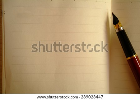 New empty note book with red ink pen - stock photo