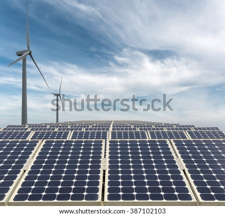 new energy background, solar panels and wind power against a blue sky. - stock photo
