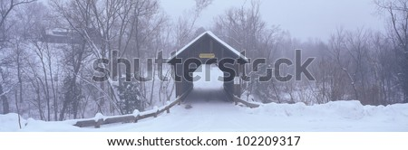 New England covered bridge in winter - stock photo