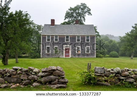 New England mansion on a foggy afternoon at Martha's Vineyard, MA - stock photo