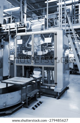 new equipment for packaging in a modern plant - stock photo