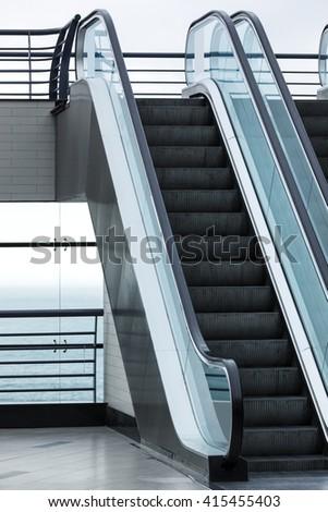 new escalator in a modern building - stock photo