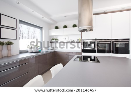 New exclusive kitchen with big cooking space - stock photo