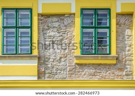 New Facade of a Building With the Fragment of Old One - stock photo