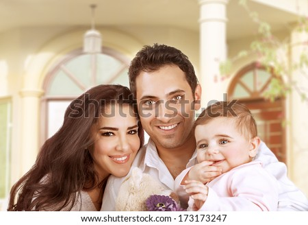 New family house, successful young parents with little baby having fun in country house, young cheerful owner of real estate, happy lifestyle concept  - stock photo