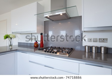New fitted kitchen with built in gas hob and extractor - stock photo