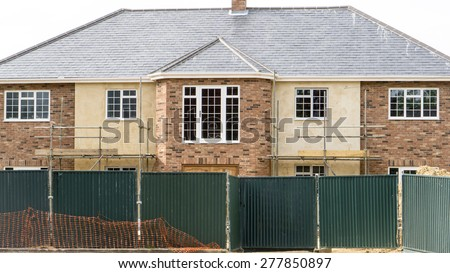 New grand English mansion house being built with details of its architecture - stock photo