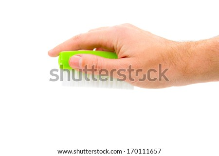 New green cleaning fetlock in hand isolated on white - stock photo