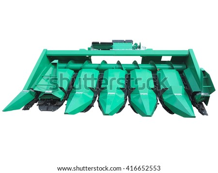 New green corn harvester agricultural tool isolated over white background - stock photo