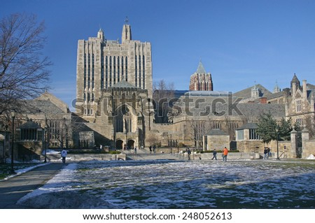 NEW HAVEN, CT - DEC 20: View of the central campus of Yale University, one of the most elegant Ivy League schools, with the Sterling Library at the left side in New Haven, CT on December 20 2006.  - stock photo