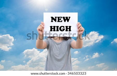 New high stats concept of stock market by asian women show the signboard with blue sky background - stock photo
