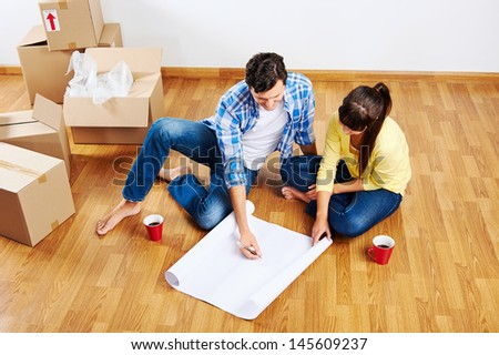new home floor plans couple moving in - stock photo