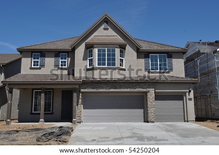 New Home Under Construction with blue sky - stock photo