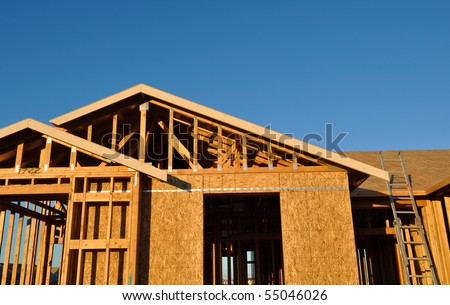 New Home under Construction with Ladder and Blue Sky - stock photo
