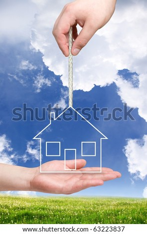 new house concept. House on the rope - stock photo