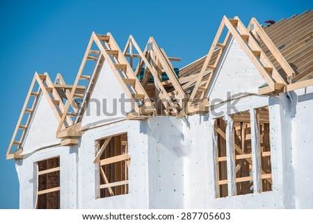 New House Construction Closeup Photo. House Wooden Construction. - stock photo