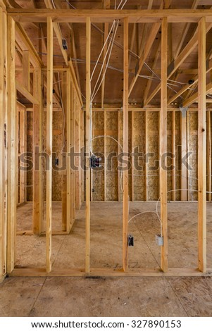 New house construction with frame - stock photo