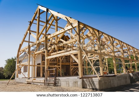 New house post and beam construction - stock photo