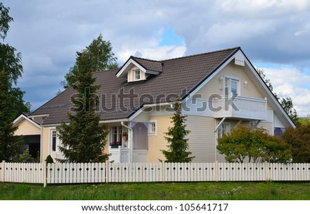 new house with a garden in the countryside - stock photo