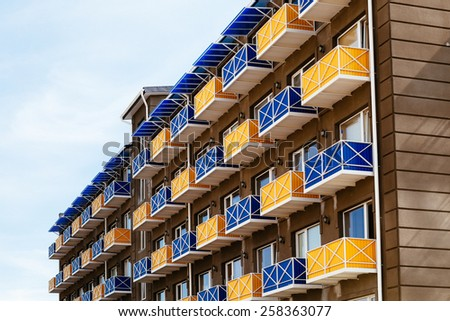 New house with colored balconies - stock photo