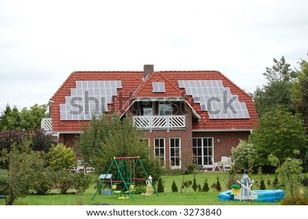 New house with photovoltaic - stock photo