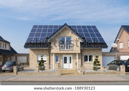 new house with solar panels on its roof - stock photo