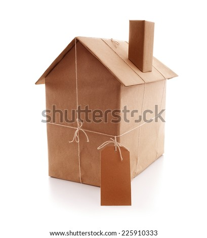 New house wrapped in brown paper concept for real estate, buying a new home, construction or moving house - stock photo