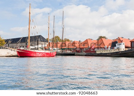 new houses and living boats on canal in Copenhagen, Denmark - stock photo