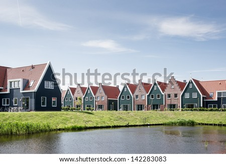 New houses in the idyllic landscape, Volendam, Netherlands - stock photo