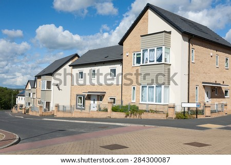 New Houses on a Typical English Residential Estate - stock photo