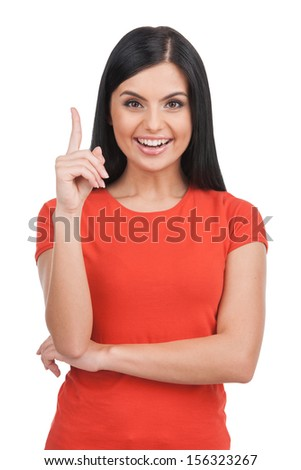 New idea. Cheerful young woman holding her thumb up and smiling while standing isolated on white  - stock photo