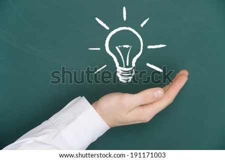 New idea concept. Man holding a good idea.  - stock photo
