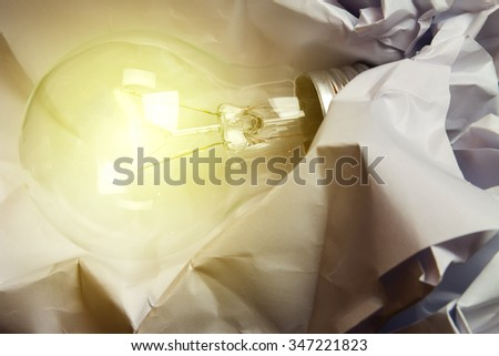 new idea concept with  light bulb and paper. - stock photo