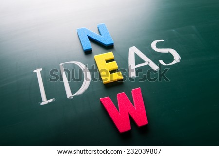 New ideas, words on blackboard with colorful alphabets. - stock photo