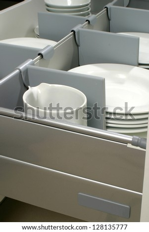 new kitchen drawer with plates - stock photo