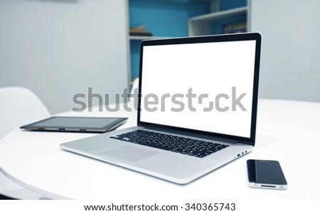 New laptop and tablet and phone on table - stock photo