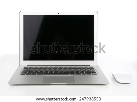 New laptop display with keyboard and mouse isolated on a white background - stock photo